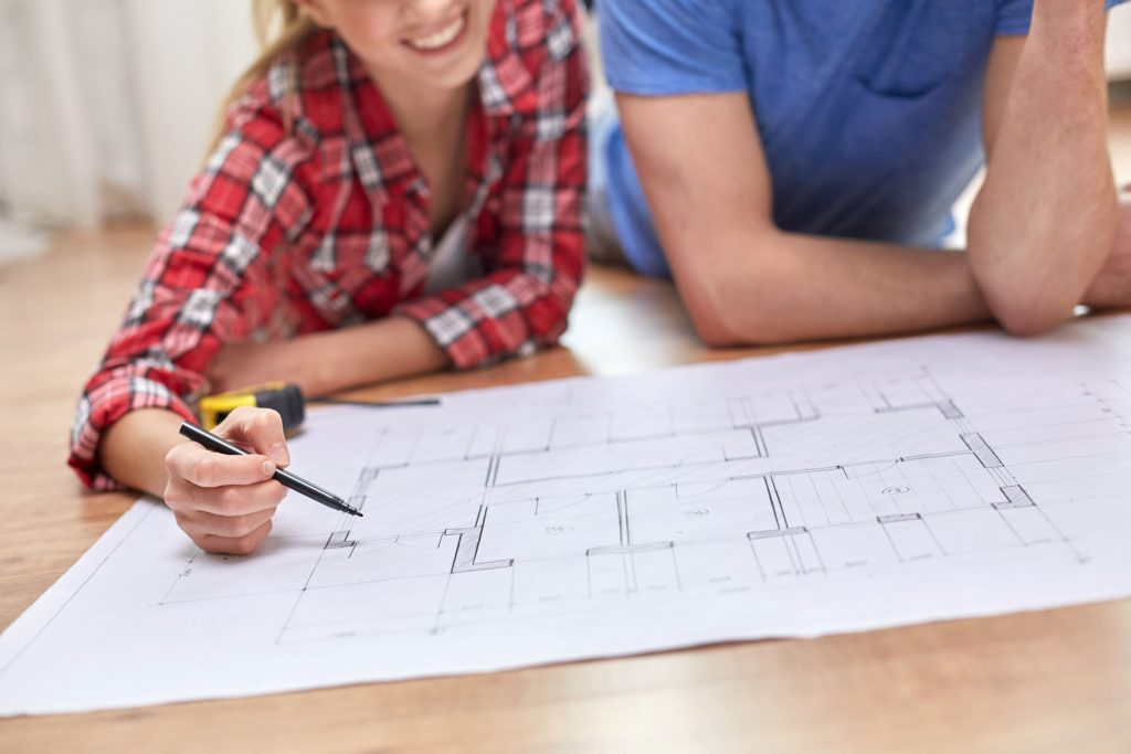 Couple reviewing blueprints